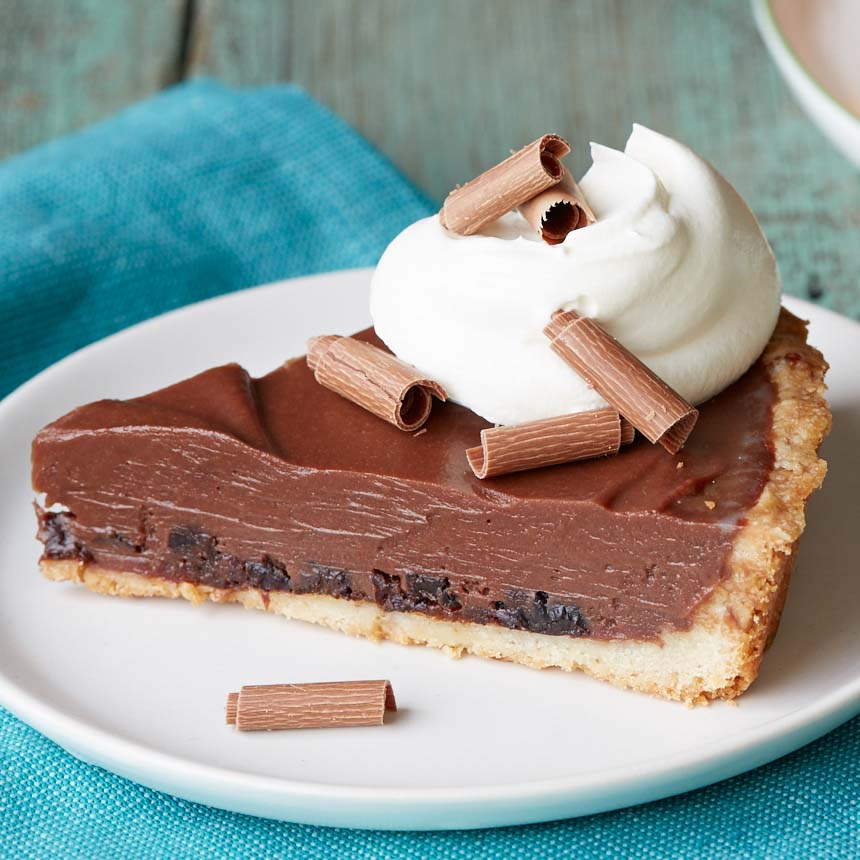 <p>The layered filling—Diced Dried Plums topped with a chocolate cream—gives this tart a simple but sophisticated appearance. Balancing the creamy filling is a nutty, shortbread-like pastry crust, a classic pairing with prunes.</p>