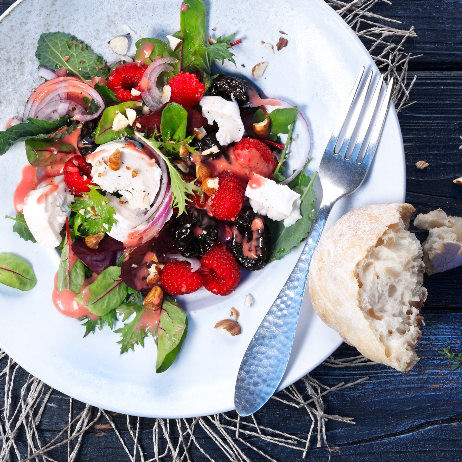 <p>Prunes and goat cheese are great together any time of the year. When making this salad in the winter, use roasted, diced beets in place of raspberries. 309 kcal (1293 kJ); protein 9.3 g; fat 17.3 g; carbohydrates 27.2 g</p>
