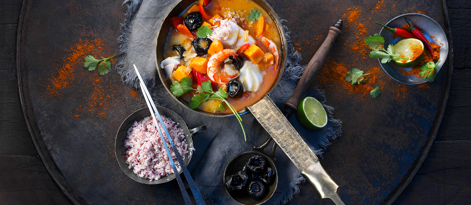 Full of color and flavor, this Southeast Asian fish curry is an unexpected twist on a classic curry. Tamarind is a typical seasoning ingredient in fish curries because it delivers bright flavor. While sweeter, the tanginess of prunes can achieve a similar effect. For a variation, try soaking prunes in lime juice before adding them to the curry.