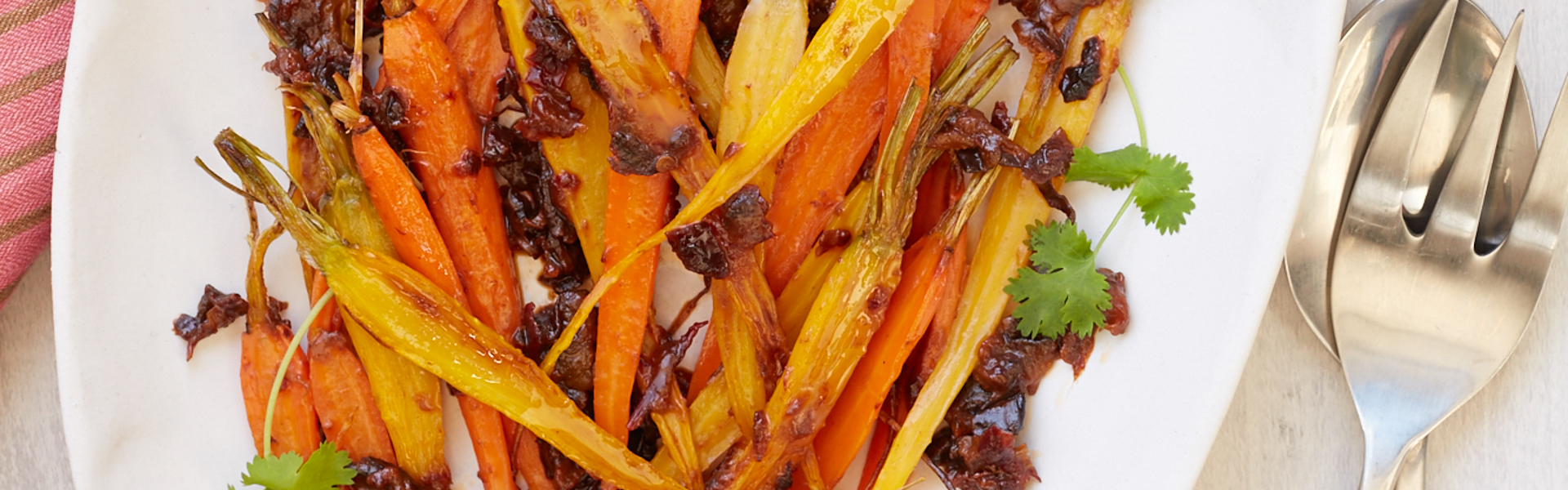 <p>Chipotle and prunes are a proven flavor pairing in meat and poultry dishes, but using them to coat roasted carrots gives the vegetables a deeply satisfying savory flavor.</p>