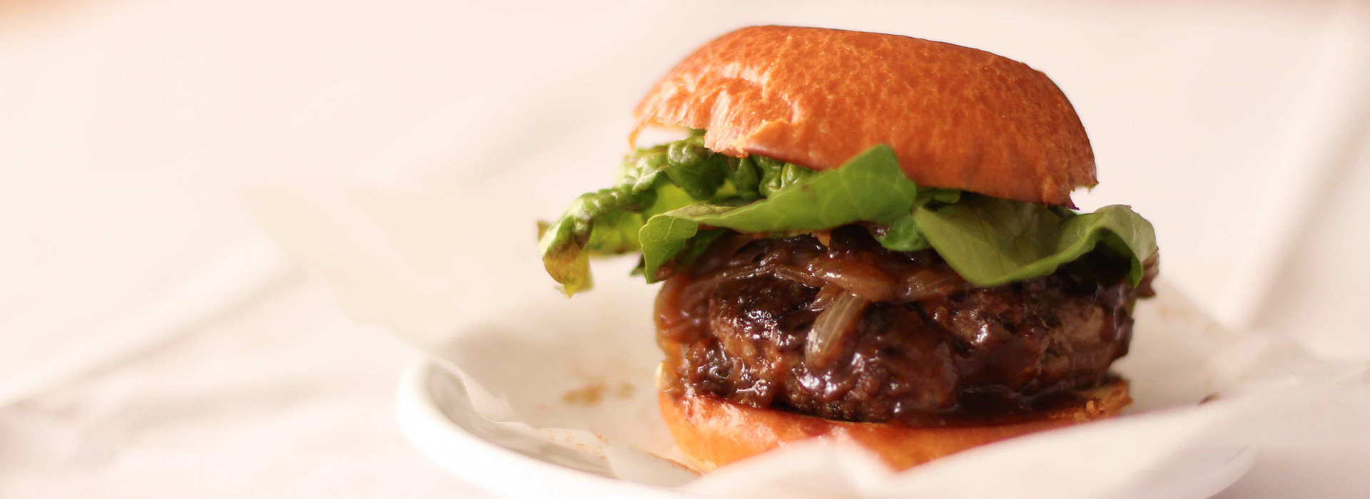 <p>Adding a little Dried Plum Purée to the ground lamb in these sliders enhances the flavors of the spices while also ensuring that the sliders stay juicy when cooked. For the full effect, top the sliders with Caramelized Onions.</p>
