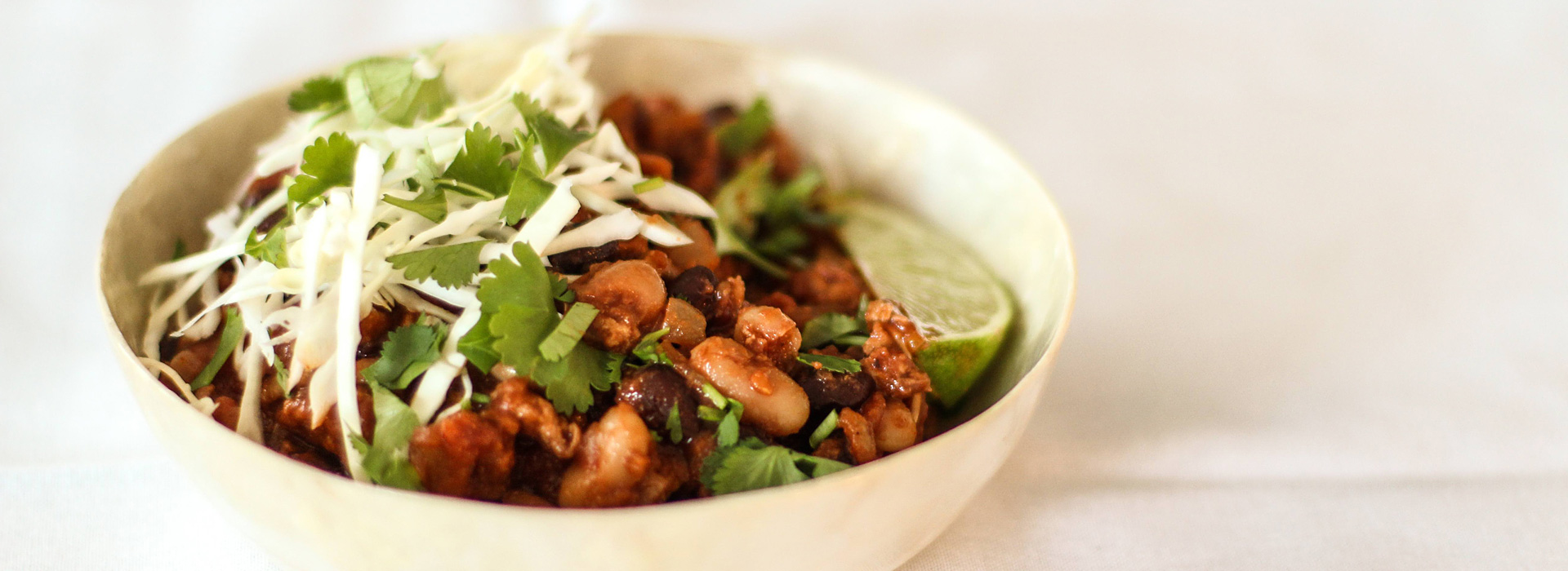 <p>Using ground chipotle peppers in place of standard chili powder makes this chili savory and subtly smoky. Dried Plum Purée enhances the flavor even more, making this ground turkey chili taste rich even though it's leaner than versions made with ground beef.</p>