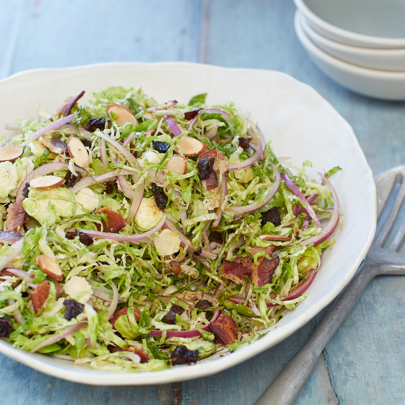 <p>Shaved Brussels sprouts make for a mild and crunchy alternative to a cabbage or kale salad. Bacon, balsamic vinegar, and prune juice concentrate bring richness and tang to the salad while diced prunes deliver texture and sweetness.</p>