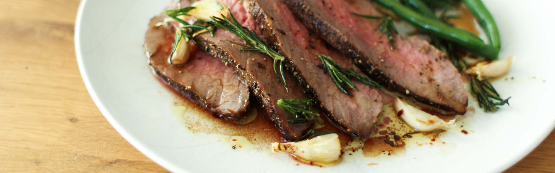 <p>The combination of using a simple marinade made with Dried Plum Puree and roasting at a high oven temperature gives tri-tip a rich, caramelized exterior. The end result is perfect for carving and serving hot, but the meat is also excellent for steak sandwiches topped with caramelized onions.</p>