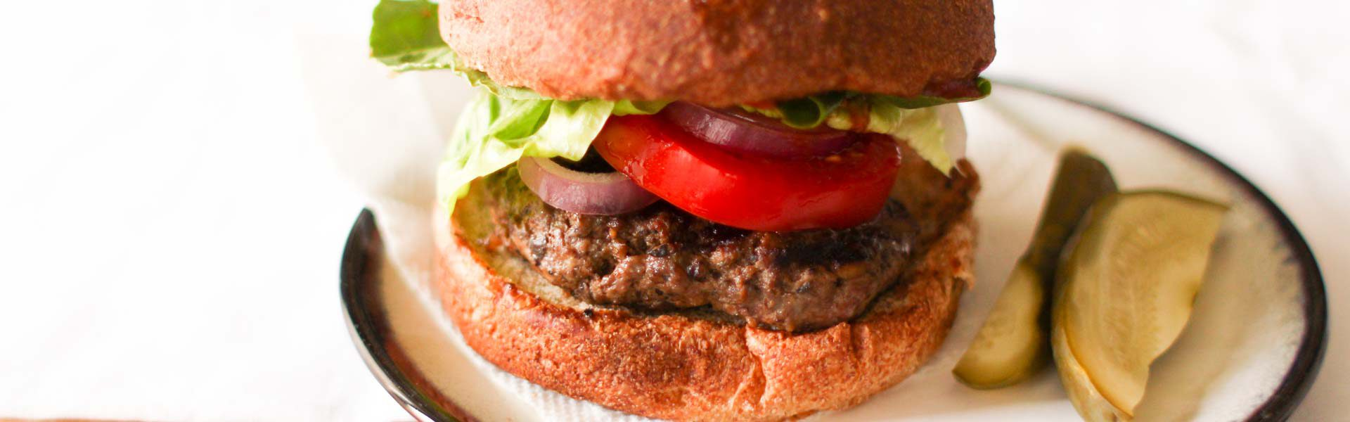 Blended Mushroom Beef Burger with Dried Plum Puree makes a burger that tastes juicy and rich without as much meat or sodium.