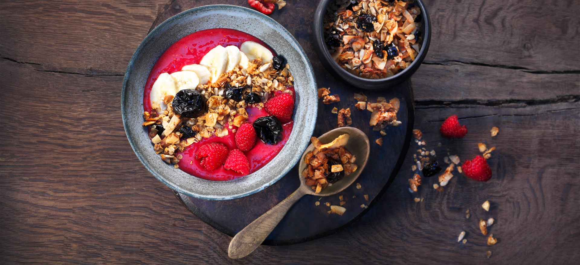 <p>This vibrant smoothie bowl combines a fruit-packed smoothie with crunchy granola, making it the perfect go-to breakfast or snack item. 446 kcal (1866 kJ); protein 8.8 g; fat 13.3 g; carbohydrates 68.8 g For a dairy-free, reduced-sugar granola, see Large Chunk Granola.</p>
