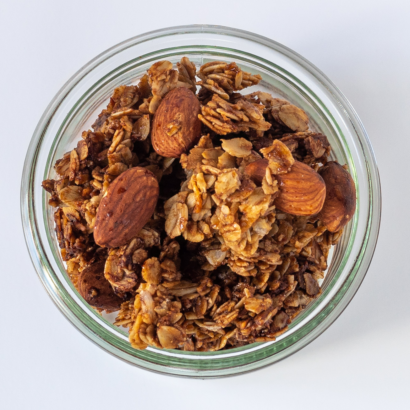 <p>This no-sugar-added granola transforms into ideal clusters for snacking, topping yogurt, or sprinkling on smoothies. Prune Juice Concentrate coats grains and nuts better than brown sugar so the oats caramelize evenly.</p>