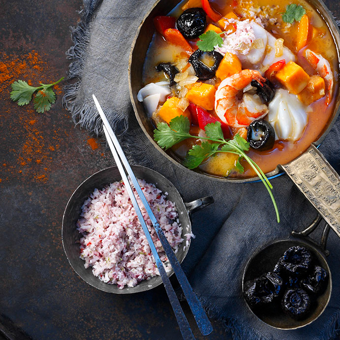 <p>Full of color and flavor, this Southeast Asian seafood curry is an unexpected twist on a classic curry. Tamarind is a typical seasoning ingredient in fish curries because it delivers bright flavor. While sweeter, the tanginess of prunes can achieve a similar effect. For a variation, try soaking prunes in lime juice before adding them […]</p>