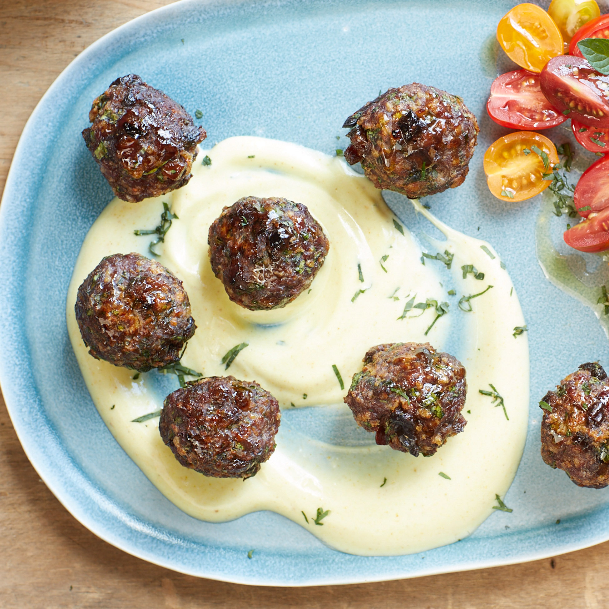 <p>The sweetness of prunes balances out the savory flavors of cumin and garlic in bite-sized lamb meatballs served with yogurt. Serve them in wraps.</p>