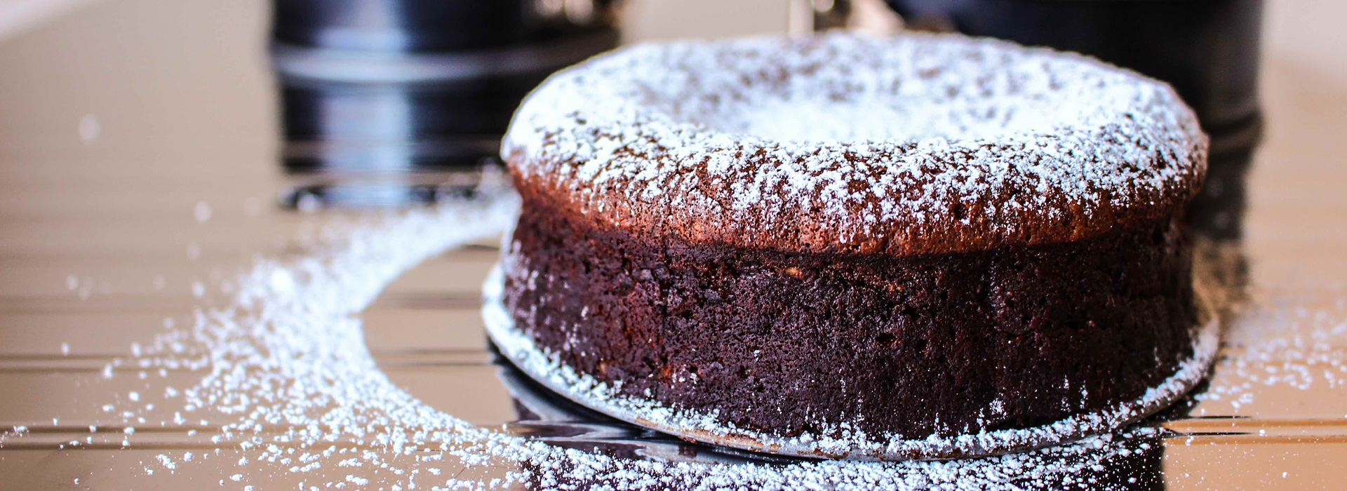 <p>This rich cake leverages a classic dessert pairing: chocolate and hazelnuts,. Here, prune puree deepens the chocolate's decadence.</p>