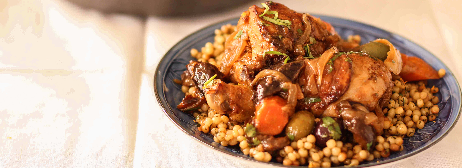 <p>Fresh Plum Concentrate used in place of honey deepens the flavor of the spices whileDiced Dried Plums enrich the braise and counter the saltiness of the olives. To complete serve the tagine in a classic style, pair it with Orange Herb Couscous.</p>