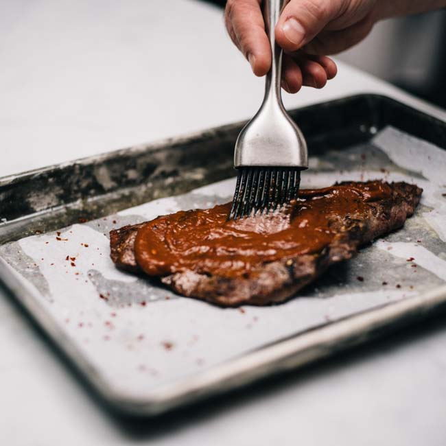 <p>In a classic barbecue sauce, Dried Plum Puree adds depth, deepening the flavor while smoked paprika and ground chipotle peppers adds smokiness.</p>