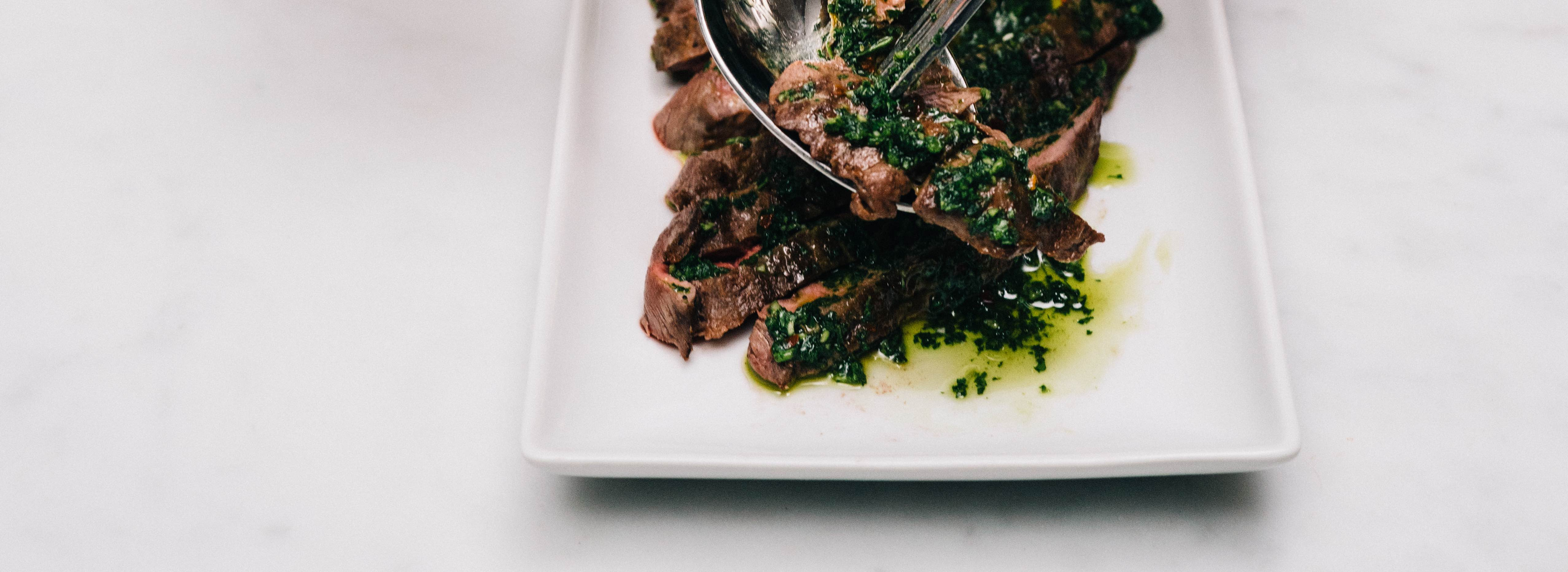 <p>Using fresh plum concentrate in chimichurri keeps the herbs from oxidizing, improving the appearance of the classic condiment.</p>