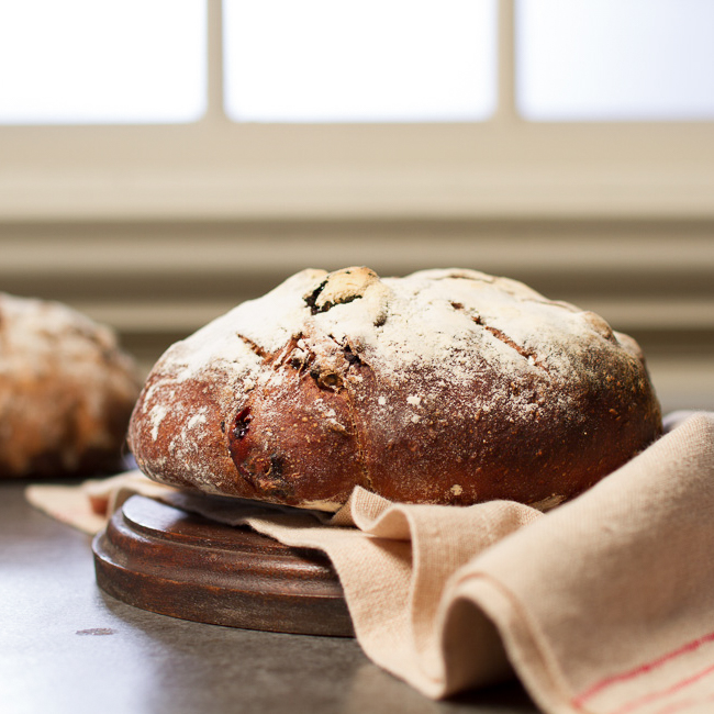 <p>Cocoa powder and sour cherries lend decadence to this bread while Diced Dried Plums provide sweetness. Serve this bread with chèvre, Gruyère, and pecorino.</p>